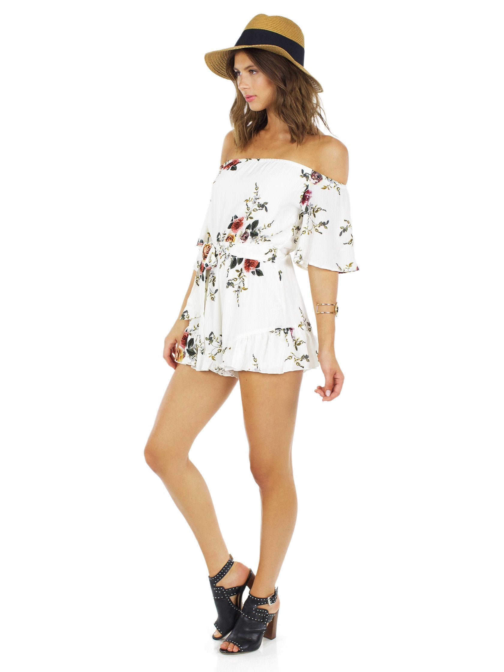 Woman wearing a romper rental from Reverse called Maude Romper