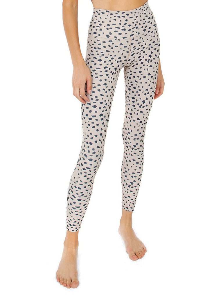 Girl wearing a leggings rental from BEACH RIOT called Cropped Farah Trouser