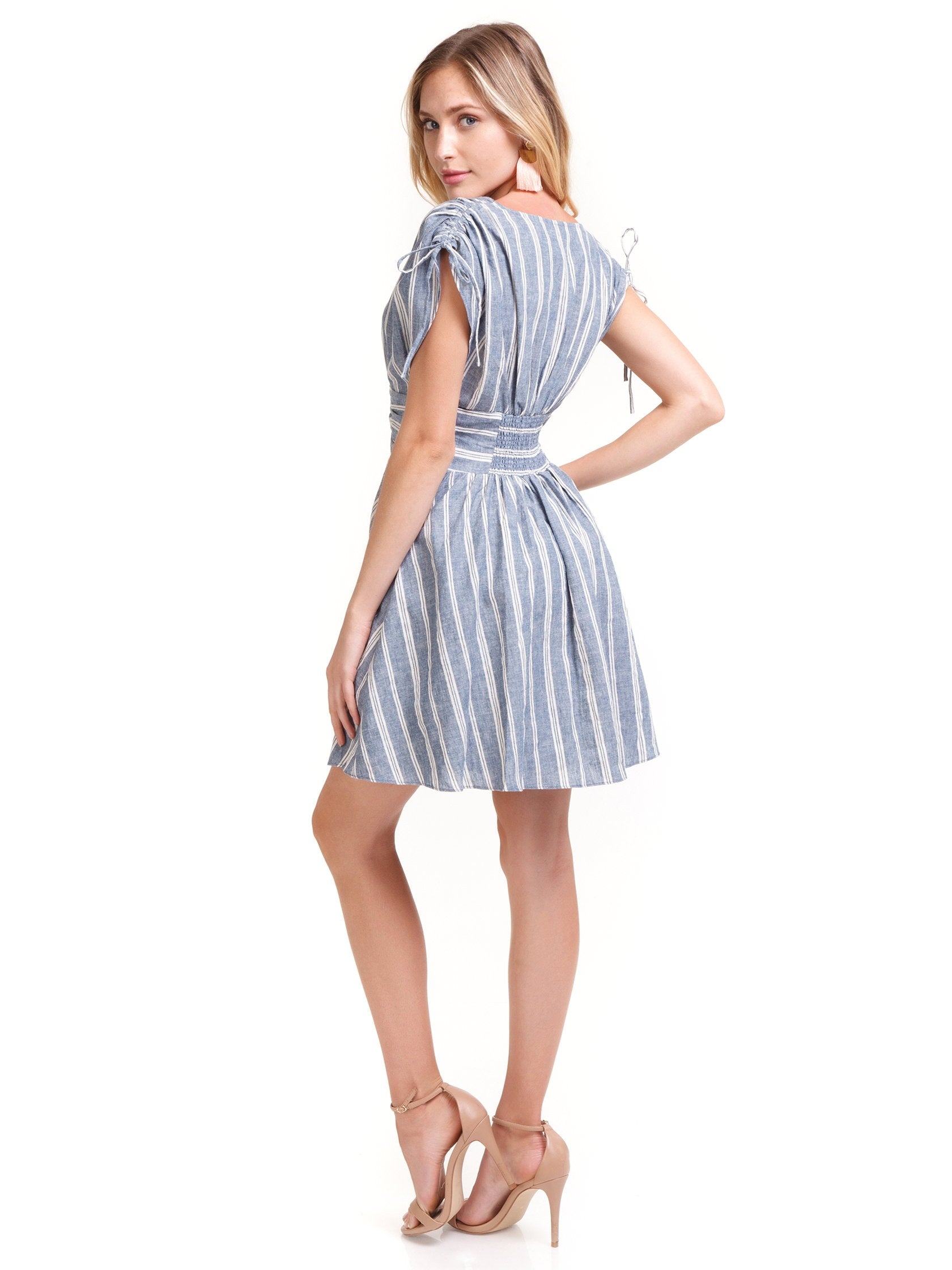 Women wearing a dress rental from Free People called Roll The Dice Striped Dress