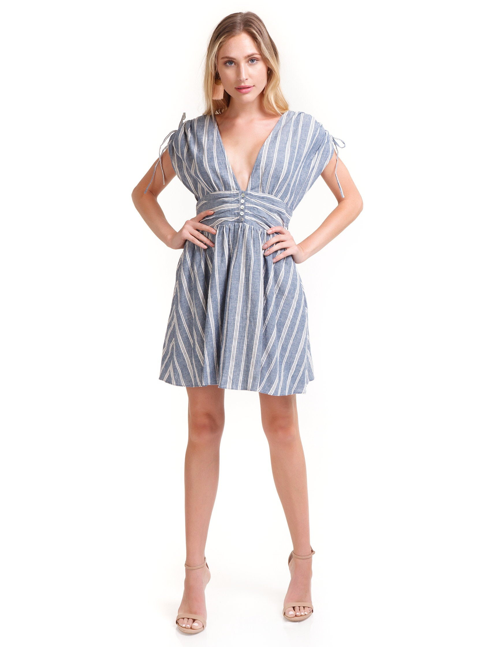 Woman wearing a dress rental from Free People called Roll The Dice Striped Dress