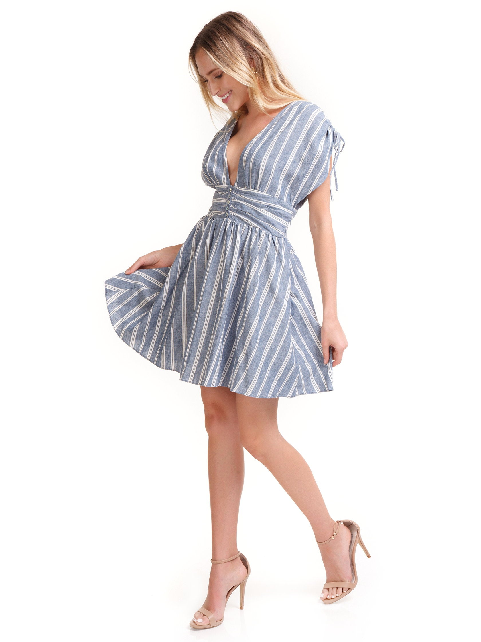 Girl outfit in a dress rental from Free People called Roll The Dice Striped Dress