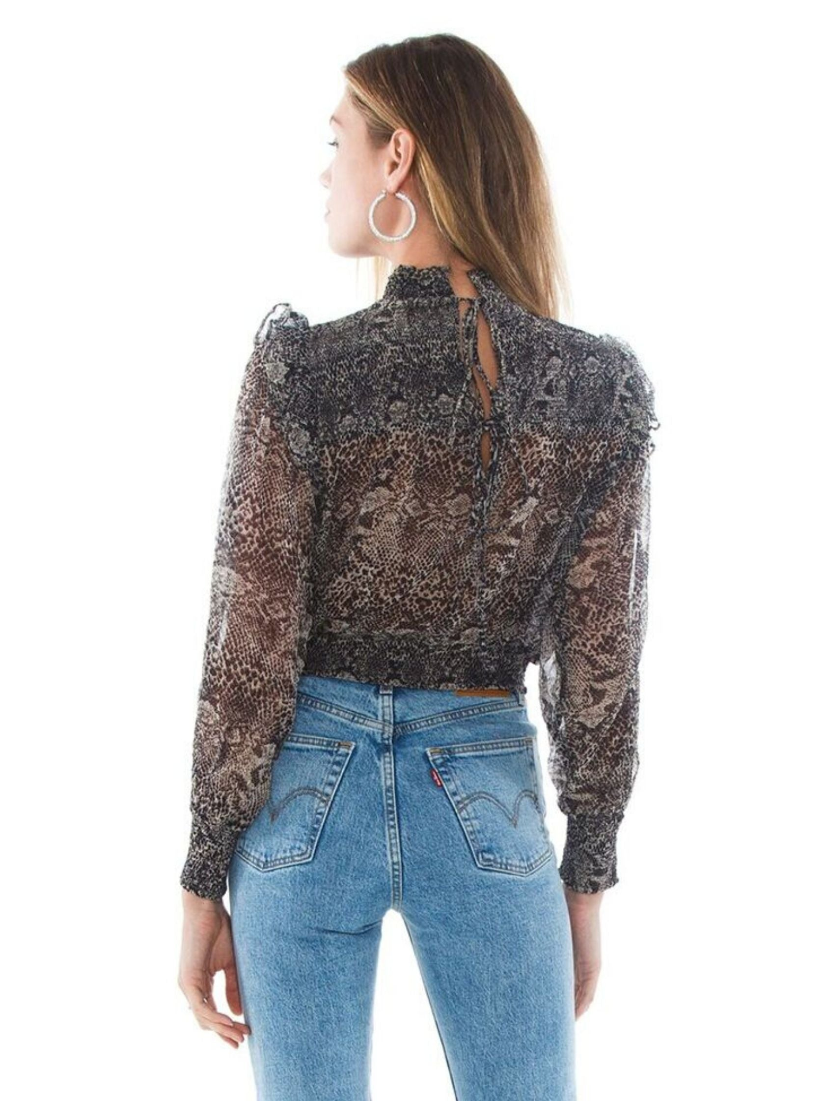 Women outfit in a top rental from Free People called Roma Blouse