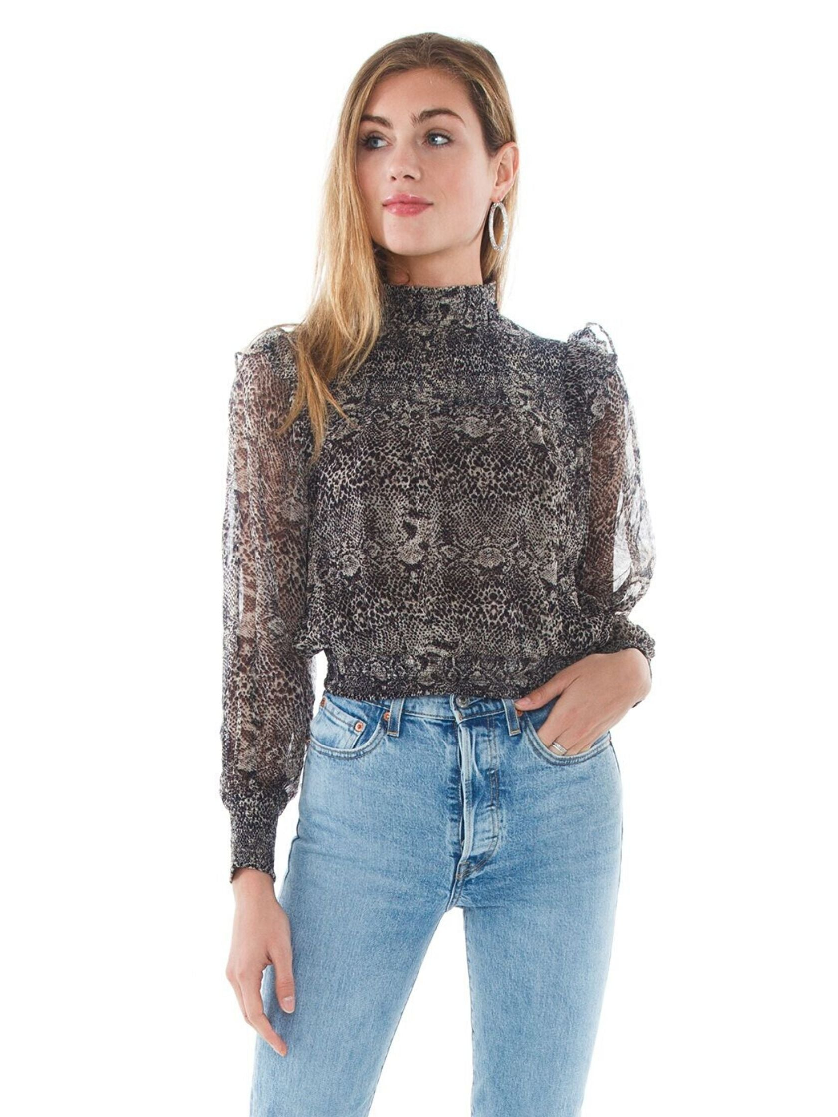 Woman wearing a top rental from Free People called Roma Blouse