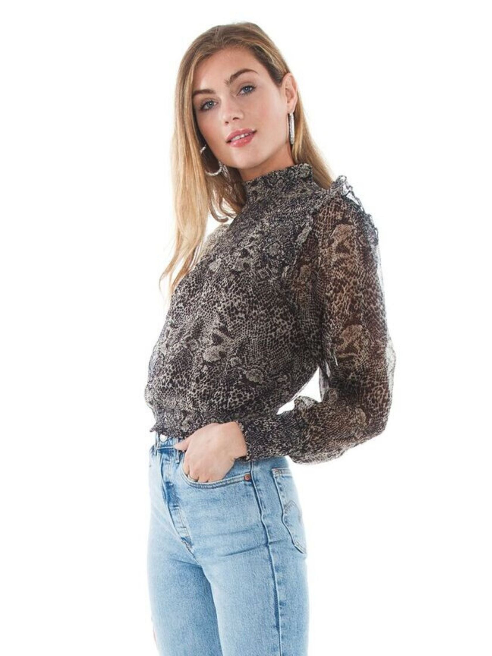 Women wearing a top rental from Free People called Roma Blouse
