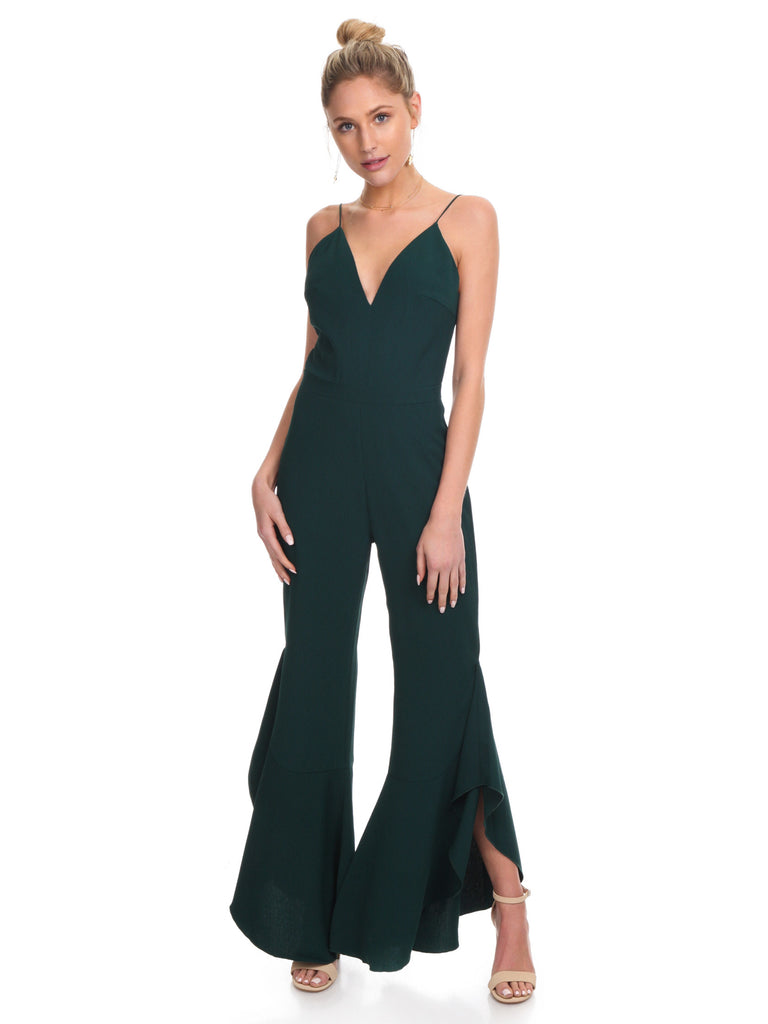 Girl wearing a jumpsuit rental from STYLESTALKER called Meryl Long Sleeve Wrap Maxi Dress