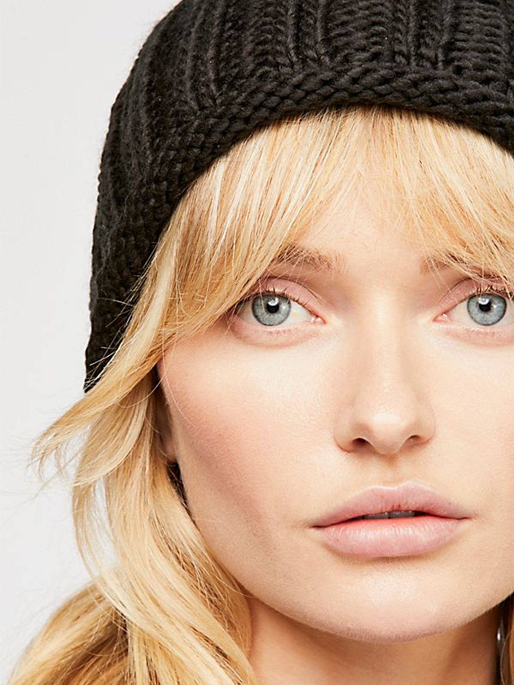 Woman wearing a hat rental from Free People called Rory Rib Knit Beanie