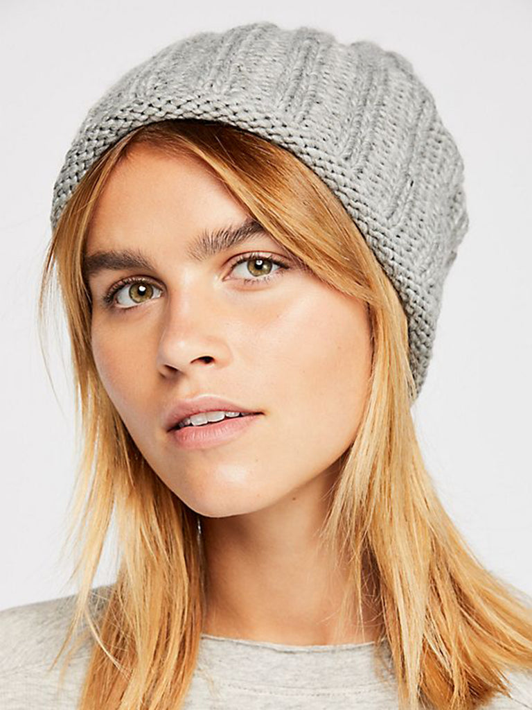 Girl wearing a hat rental from Free People called Big Sky Slouchy Beanie