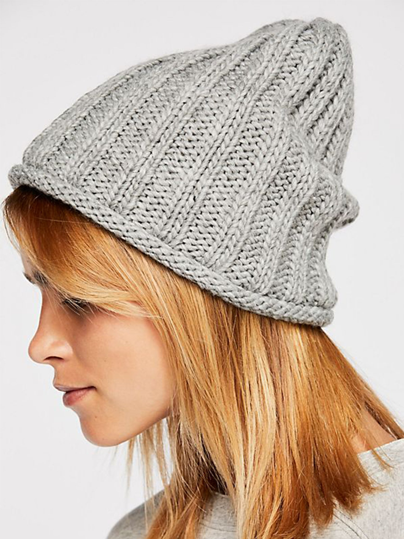 37b9115b46cadb Woman wearing a hat rental from Free People called Rory Rib Knit Beanie