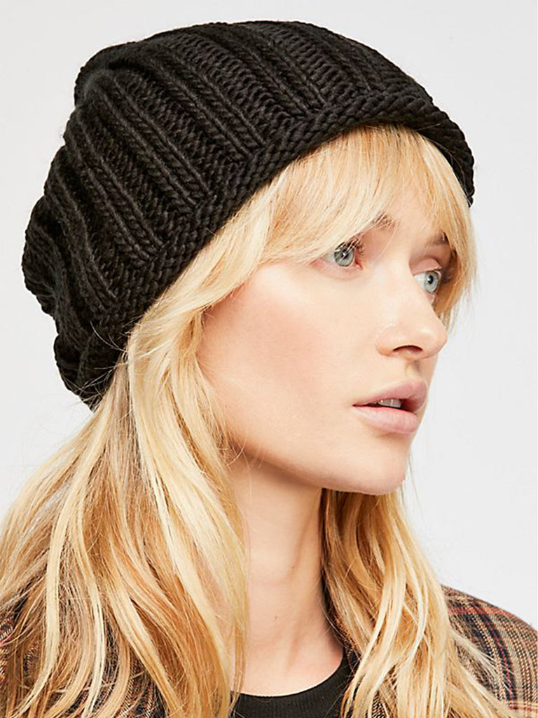 Woman wearing a hat rental from Free People called Twinkle Skinny Scarf