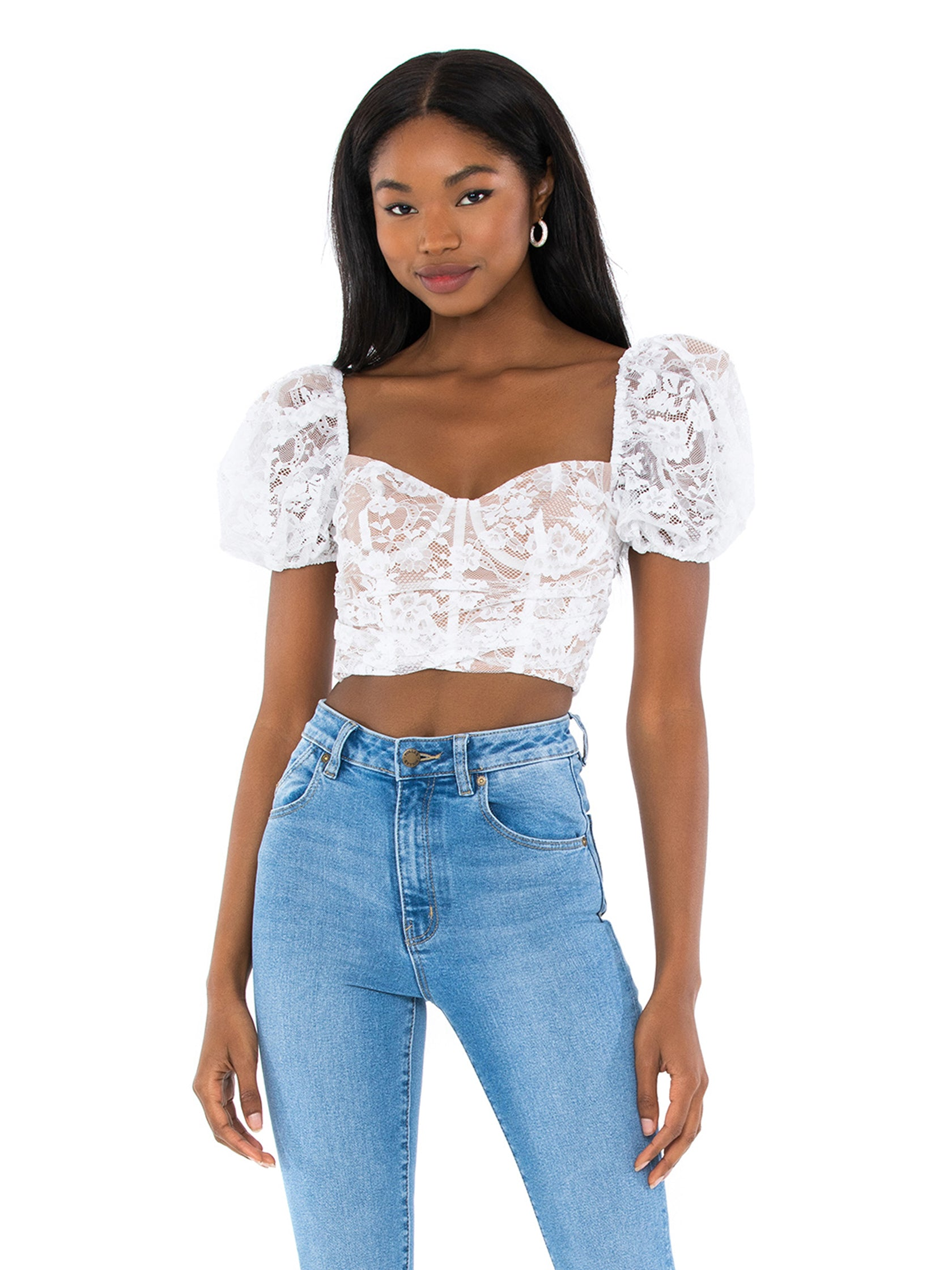 Woman wearing a top rental from For Love & Lemons called Rosalie Crop Top