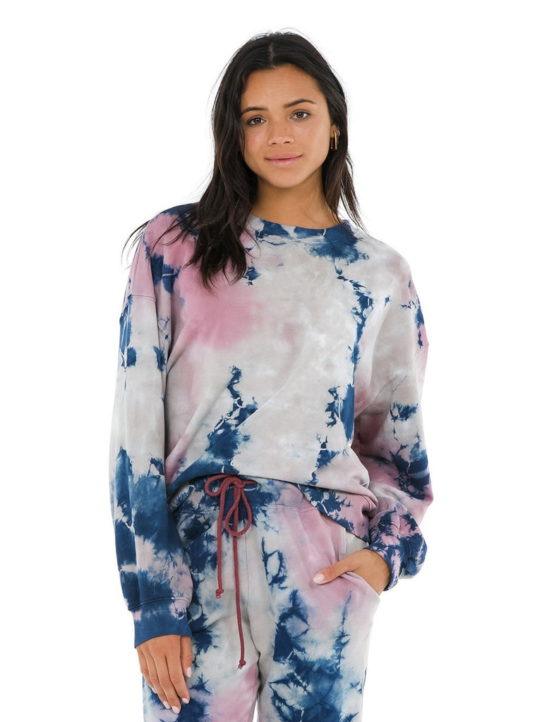 Women wearing a sweatshirt rental from DAYDREAMER called Grateful Dead Tie Dye Long Sleeve Crop