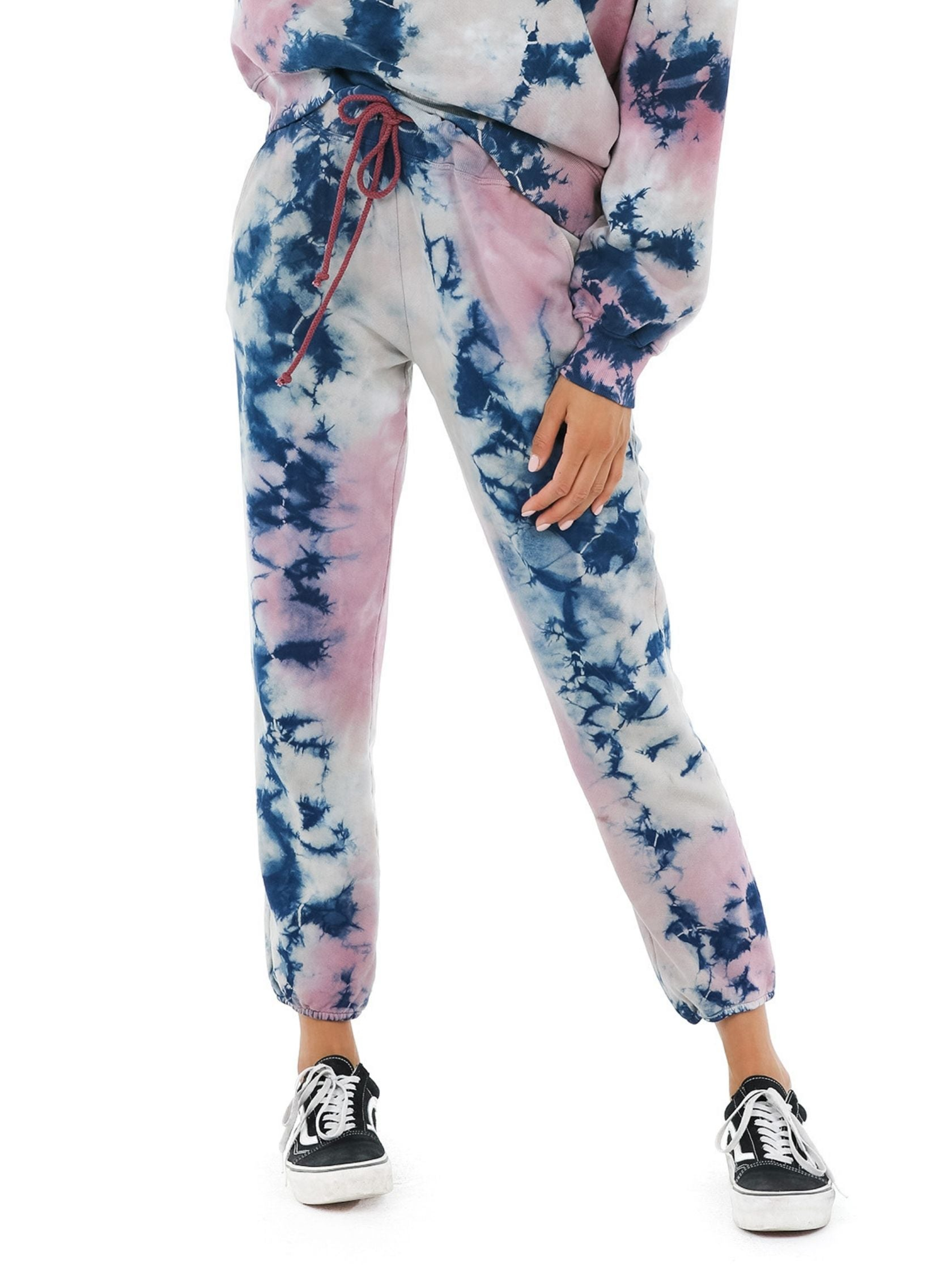 Woman wearing a joggers rental from DAYDREAMER called Rouge Storm Tie Dye Jogger