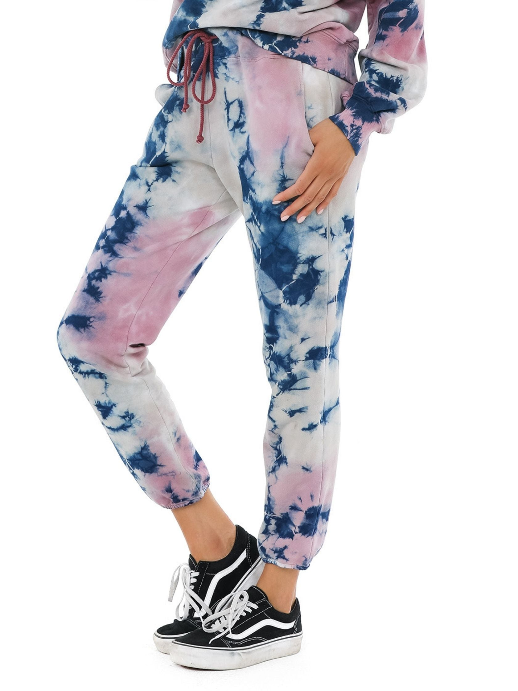 Women wearing a joggers rental from DAYDREAMER called Rouge Storm Tie Dye Jogger
