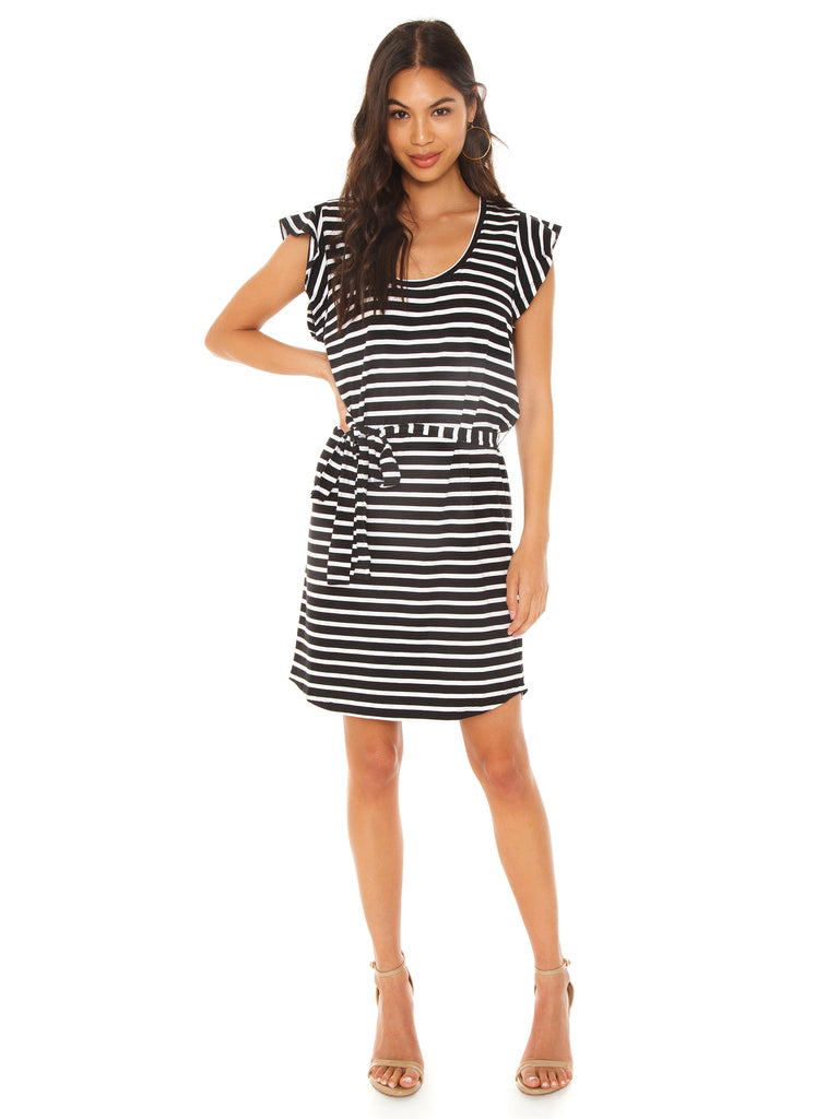 Women outfit in a dress rental from SANCTUARY called Eliza Mini Wrap Dress