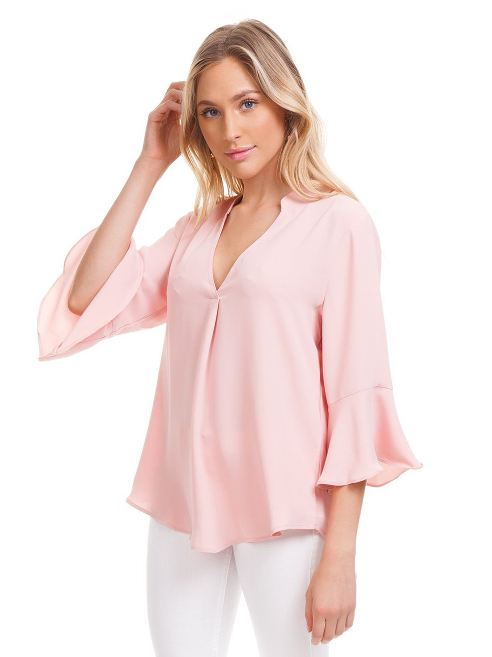 Woman wearing a top rental from Lush called V-neck Ruffle Top