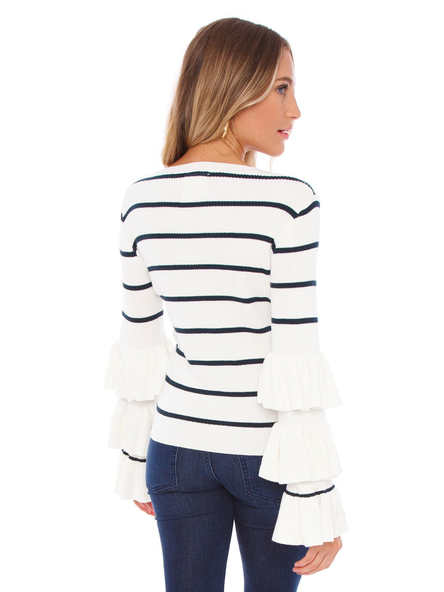 Women outfit in a sweater rental from Chaser called Ruffle Sleeve Striped Sweater