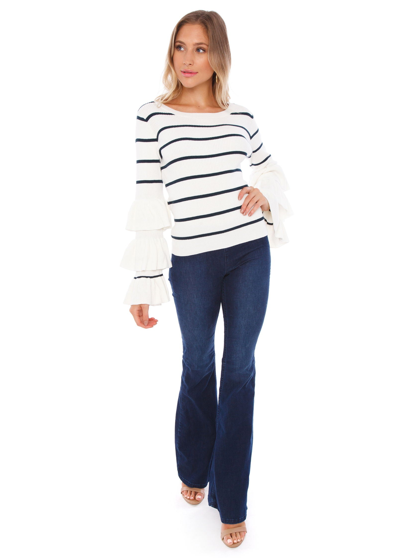 Girl wearing a sweater rental from Chaser called Ruffle Sleeve Striped Sweater