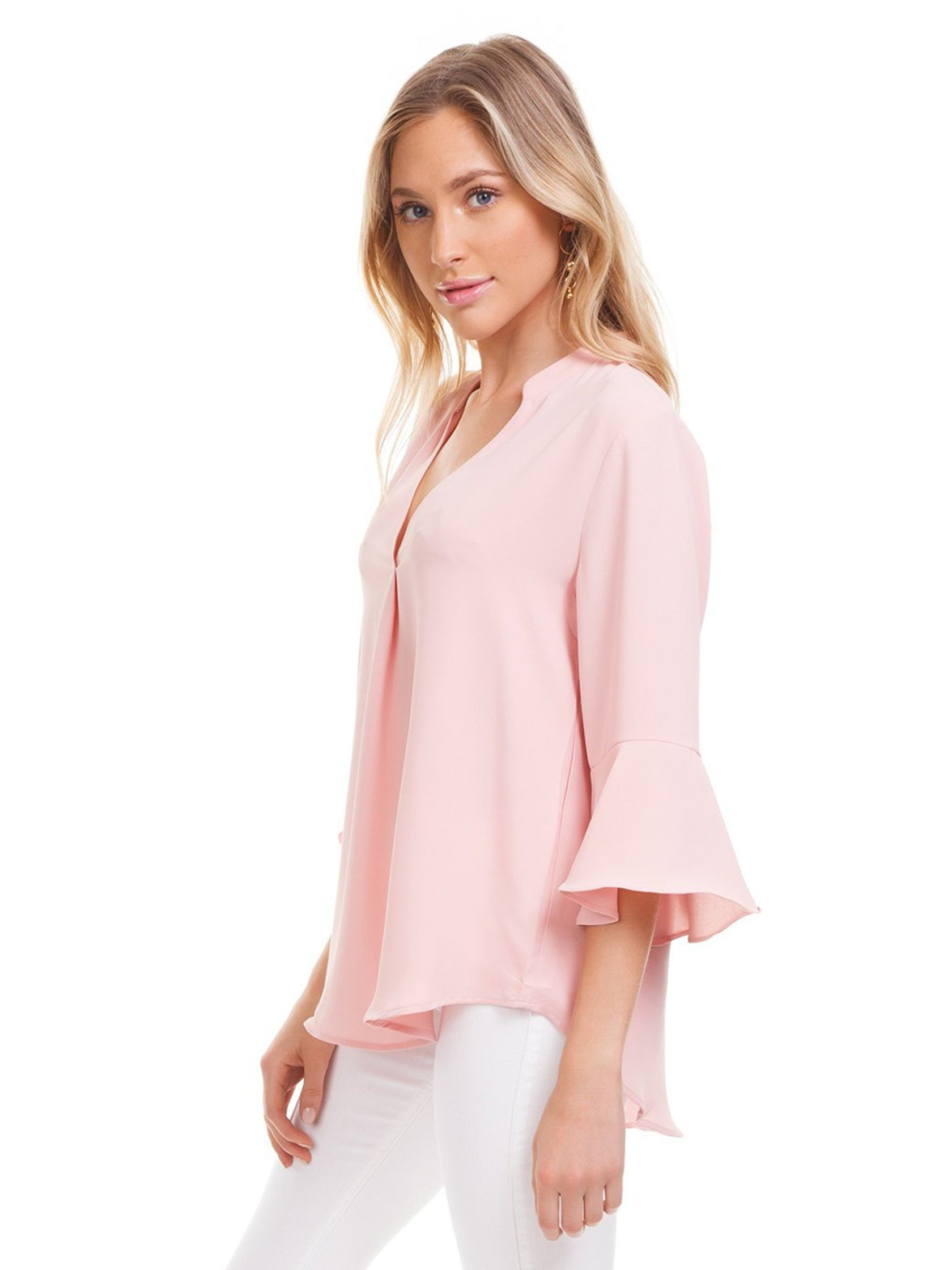 Women wearing a top rental from Lush called V-neck Ruffle Top