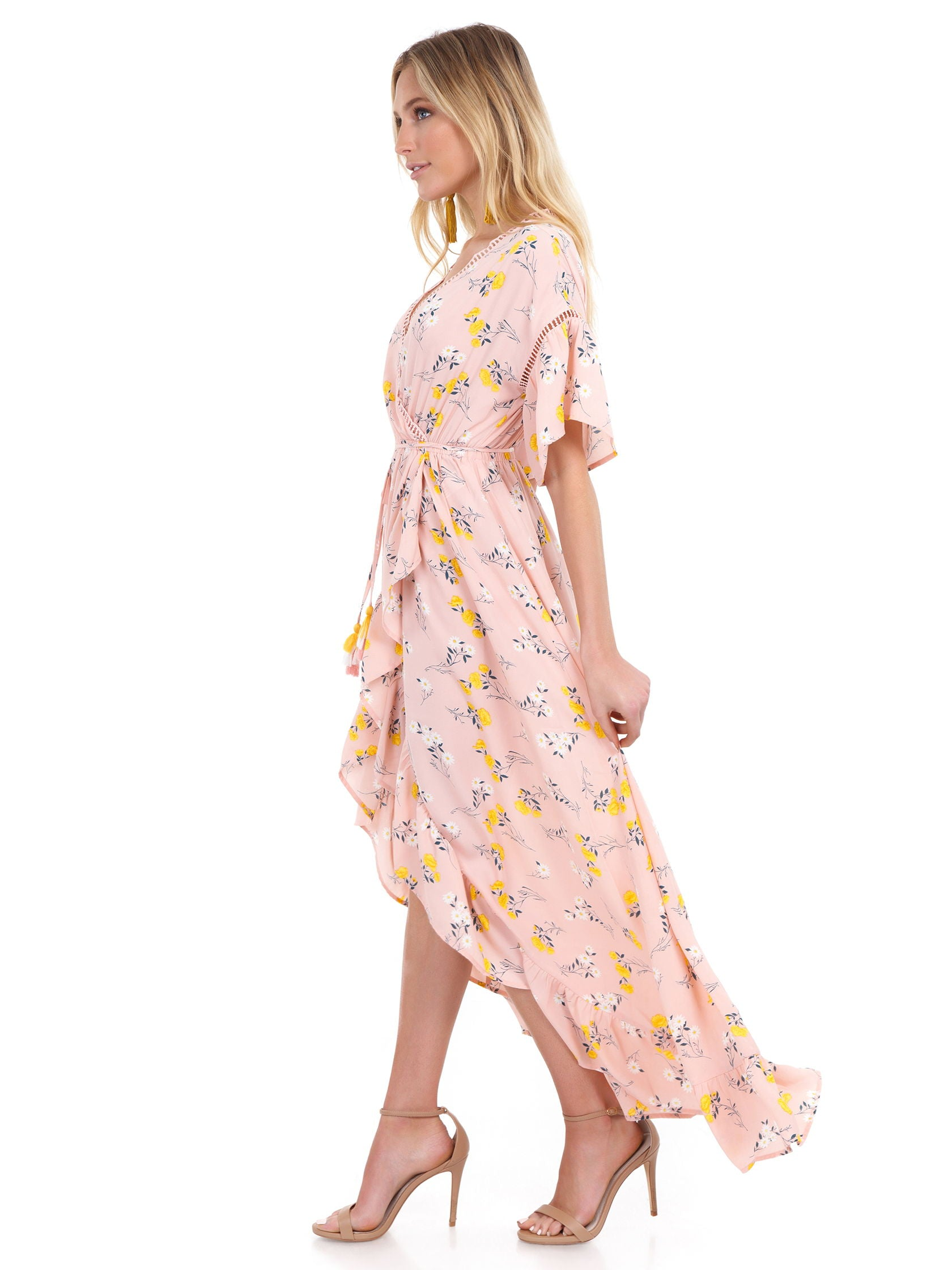 Woman wearing a dress rental from Moon River called Ruffle Sleeve Wrap Dress