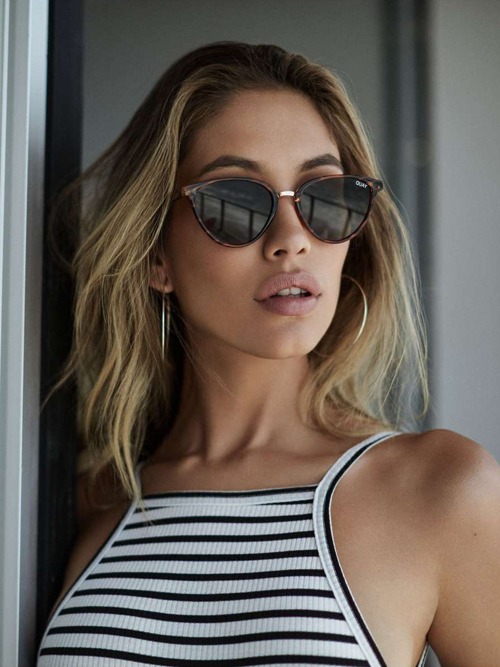 Women wearing a sunglasses rental from Quay Australia called Rumours 57mm Sunglasses