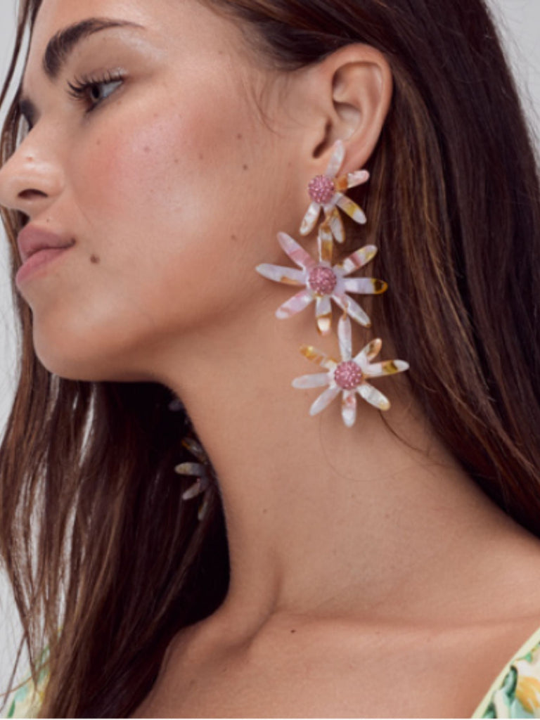 Women wearing a earrings rental from For Love & Lemons called Paula Ruched Dress