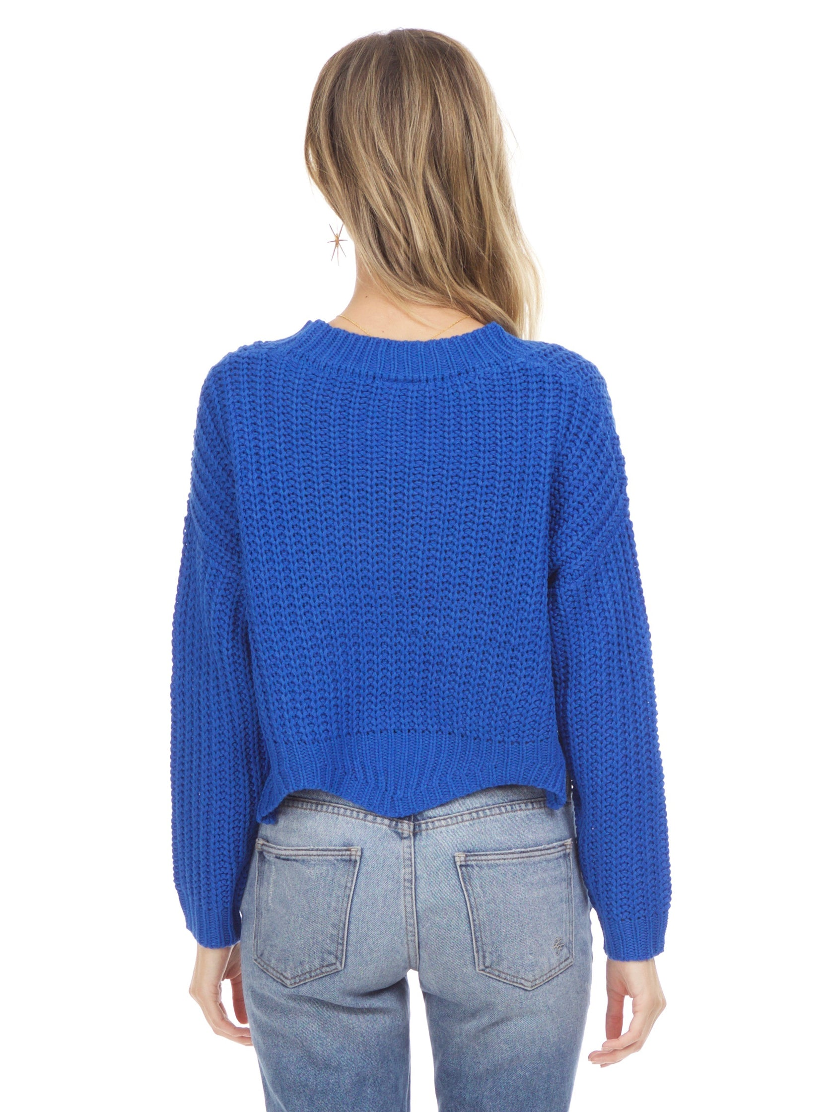 Women outfit in a sweater rental from Sadie & Sage called Scallop Hem Knit Sweater