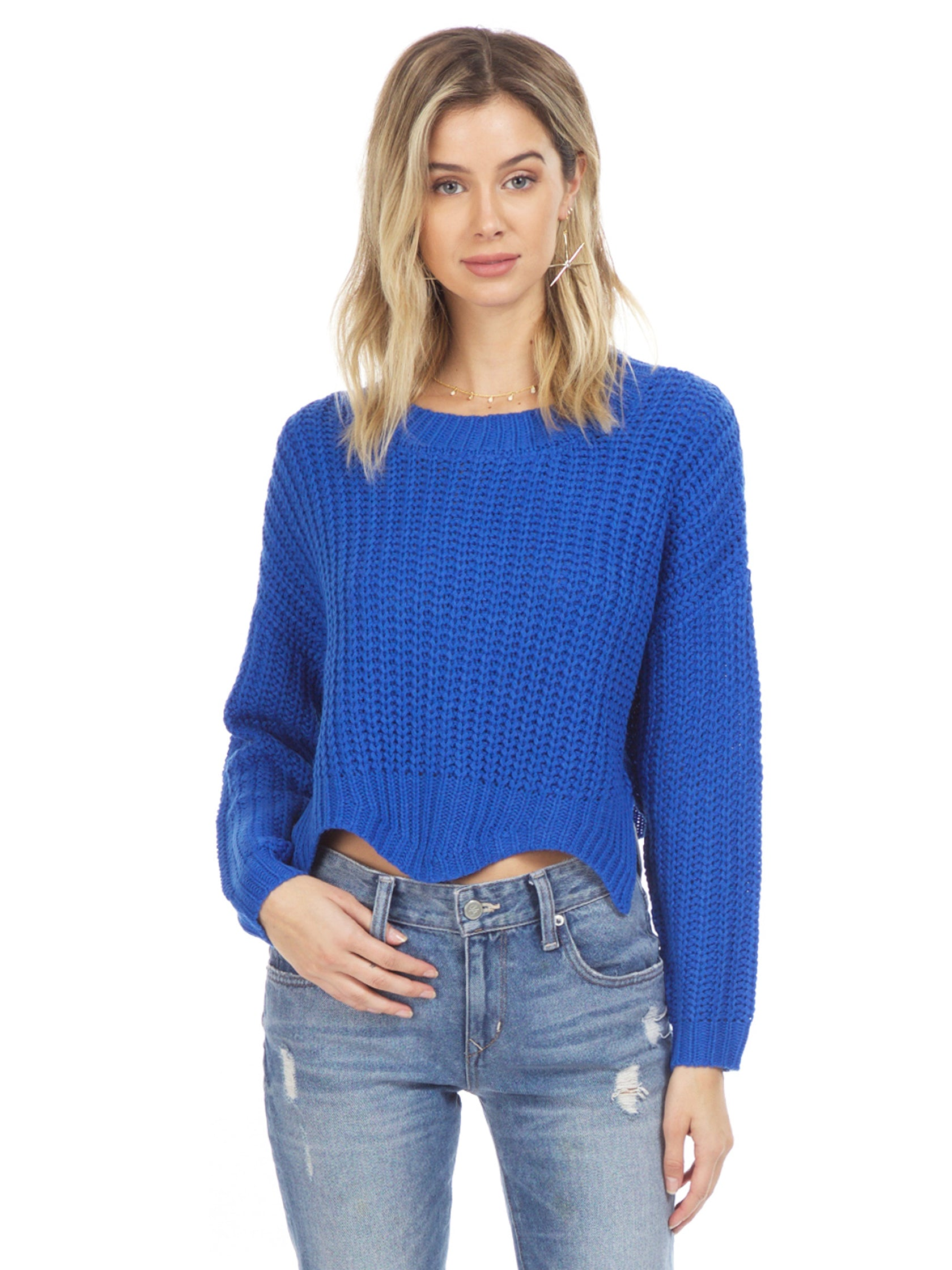 Woman wearing a sweater rental from Sadie & Sage called Scallop Hem Knit Sweater