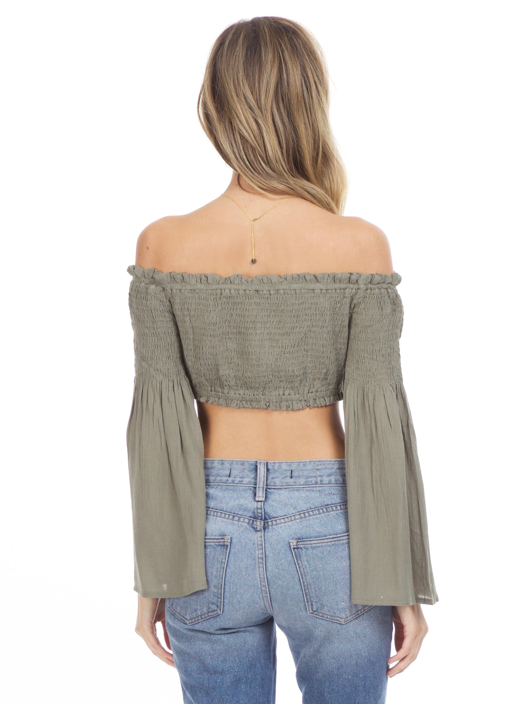 Women outfit in a top rental from Sadie & Sage called Olive Crop Top