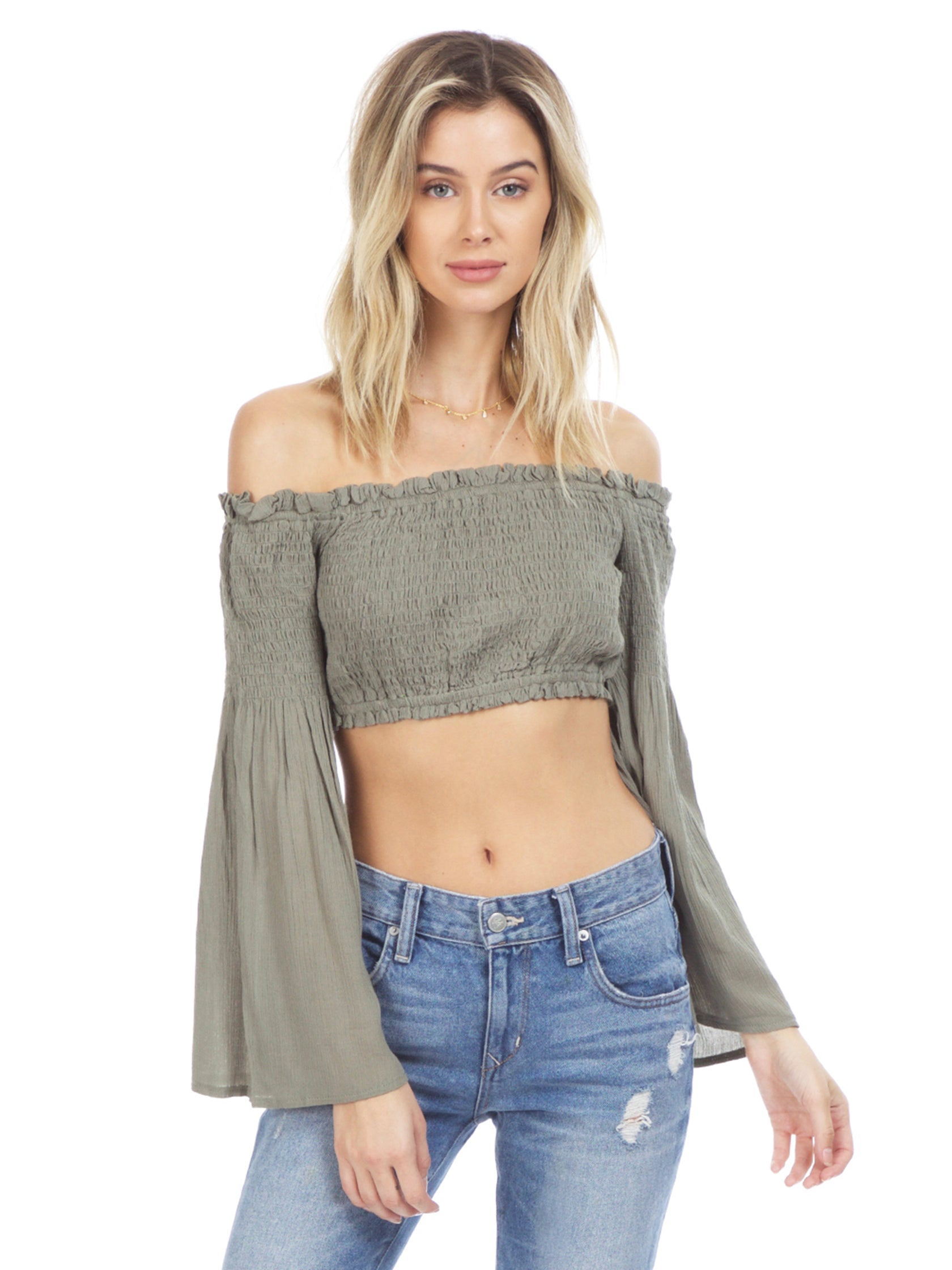 Woman wearing a top rental from Sadie & Sage called Olive Crop Top