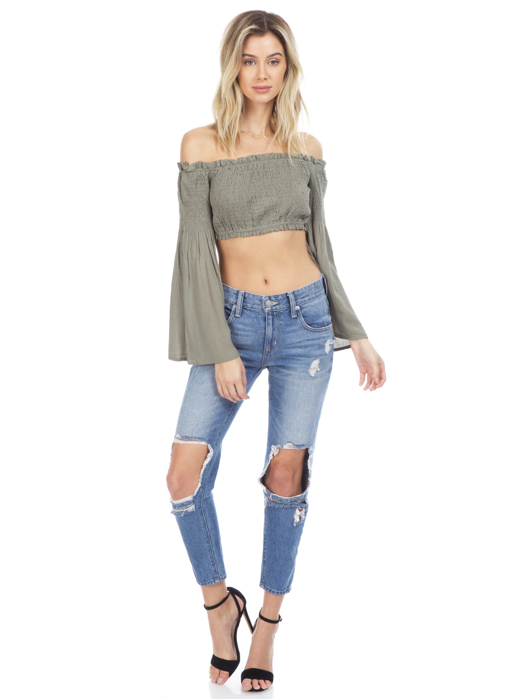 Girl wearing a top rental from Sadie & Sage called Olive Crop Top