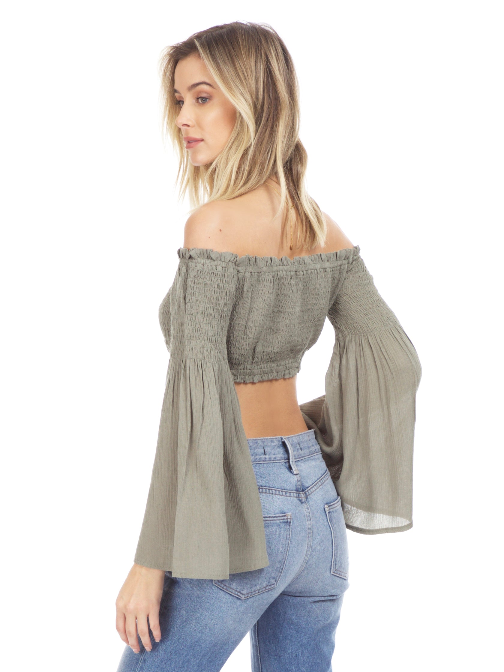 Women wearing a top rental from Sadie & Sage called Olive Crop Top