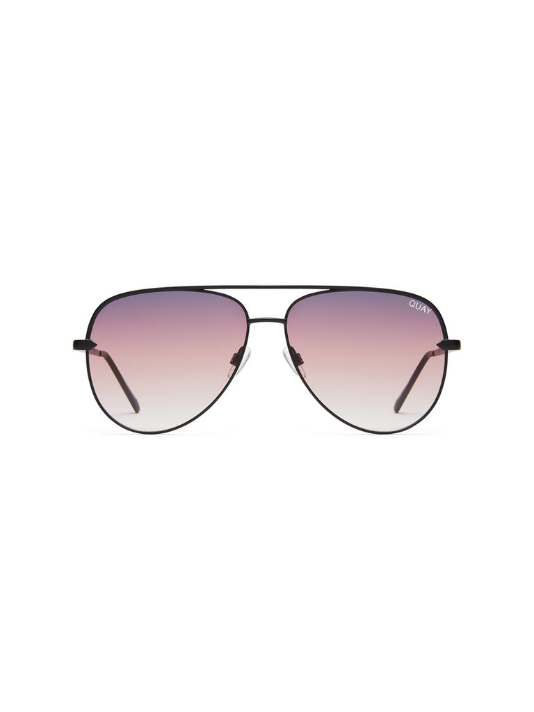 Woman wearing a sunglasses rental from Quay Australia called High Key Mini 57mm Aviator Sunglasses