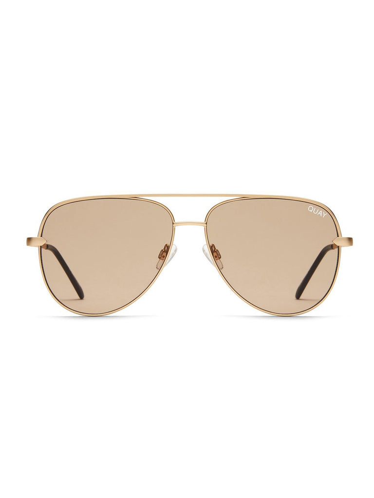 Women wearing a sunglasses rental from Quay Australia called Zodiac Gold Ring (select Your Sign)