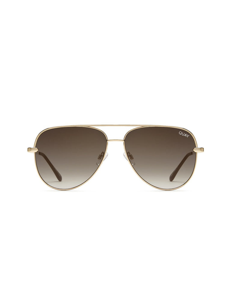 Women outfit in a sunglasses rental from Quay Australia called Zodiac Gold Ring (select Your Sign)
