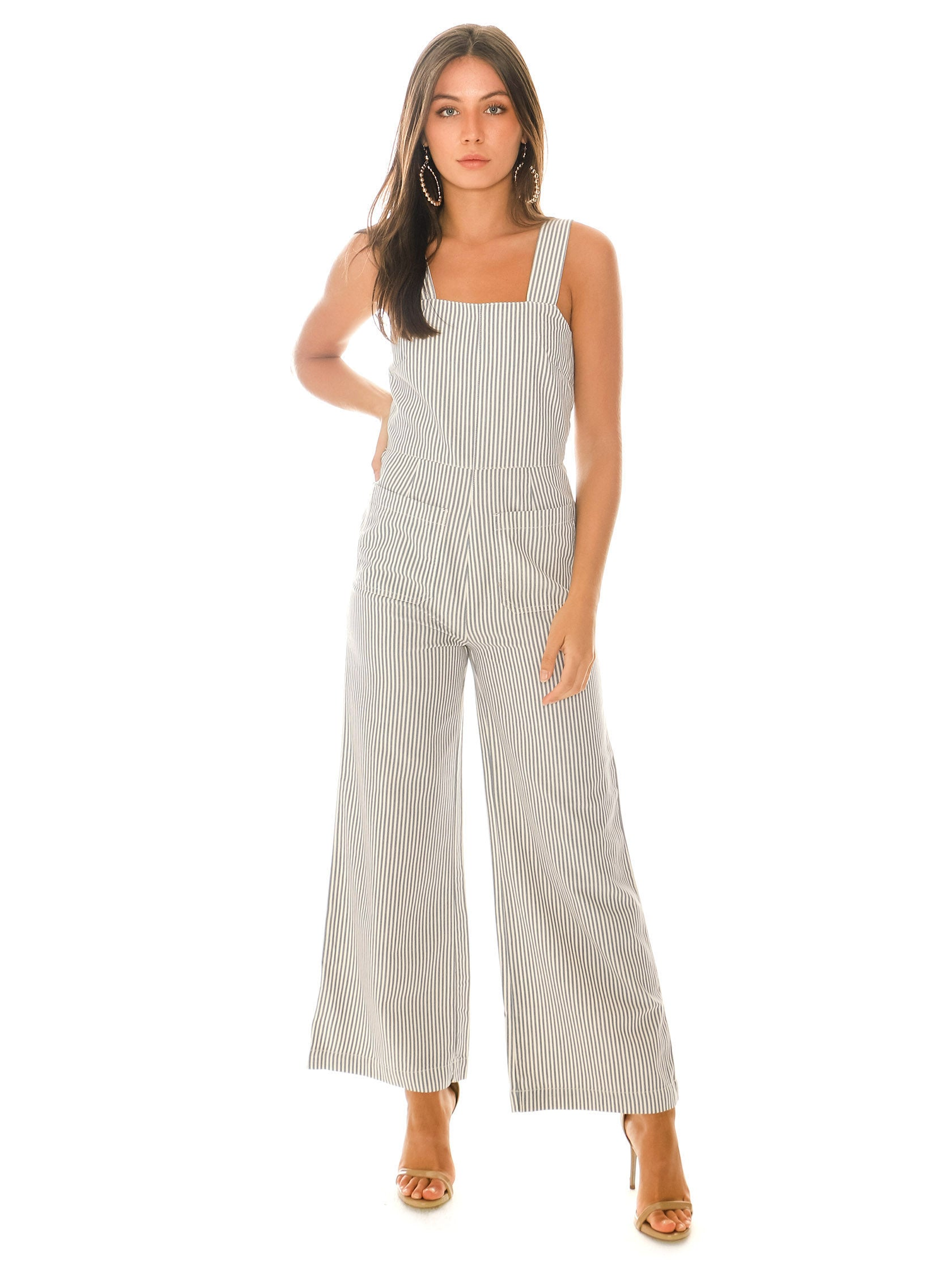 Woman wearing a jumpsuit rental from ROLLAS called Sailor Stripe Jumpsuit