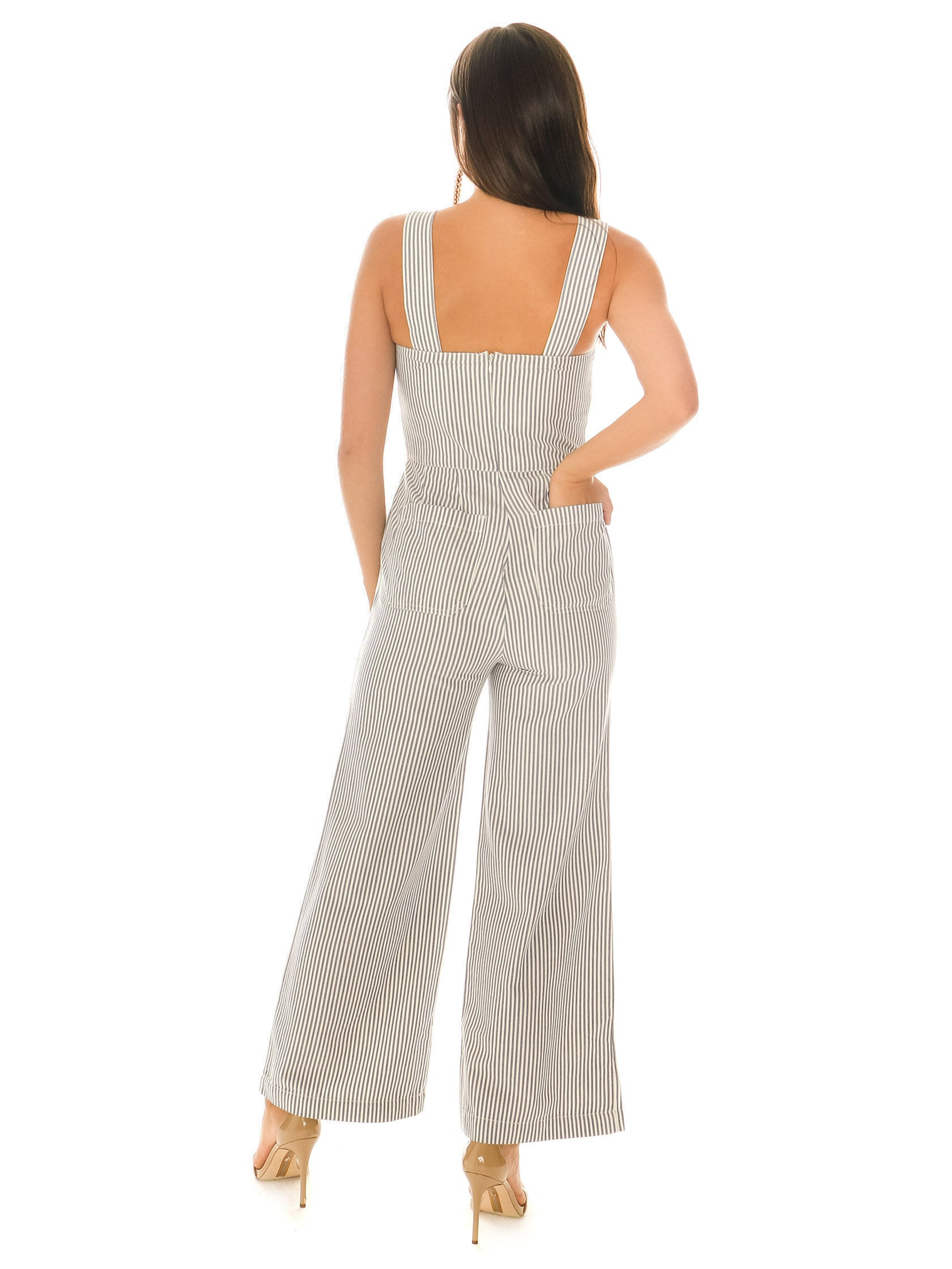 Girl wearing a jumpsuit rental from ROLLAS called Sailor Stripe Jumpsuit