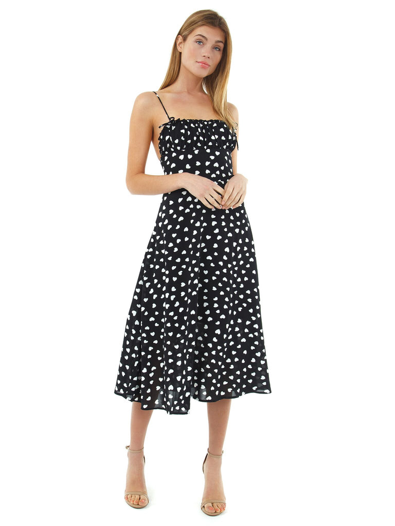 Woman wearing a dress rental from Lani The Label called Adella Slip Dress
