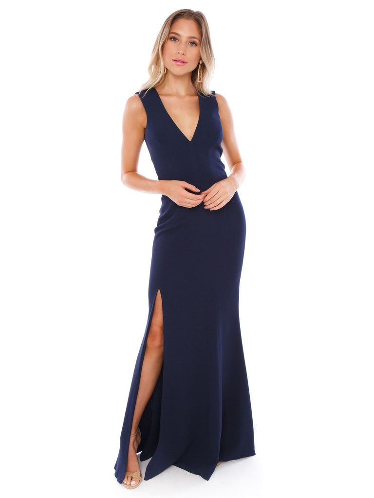 Women wearing a dress rental from Dress the Population called Georgina Crepe One-shoulder Gown