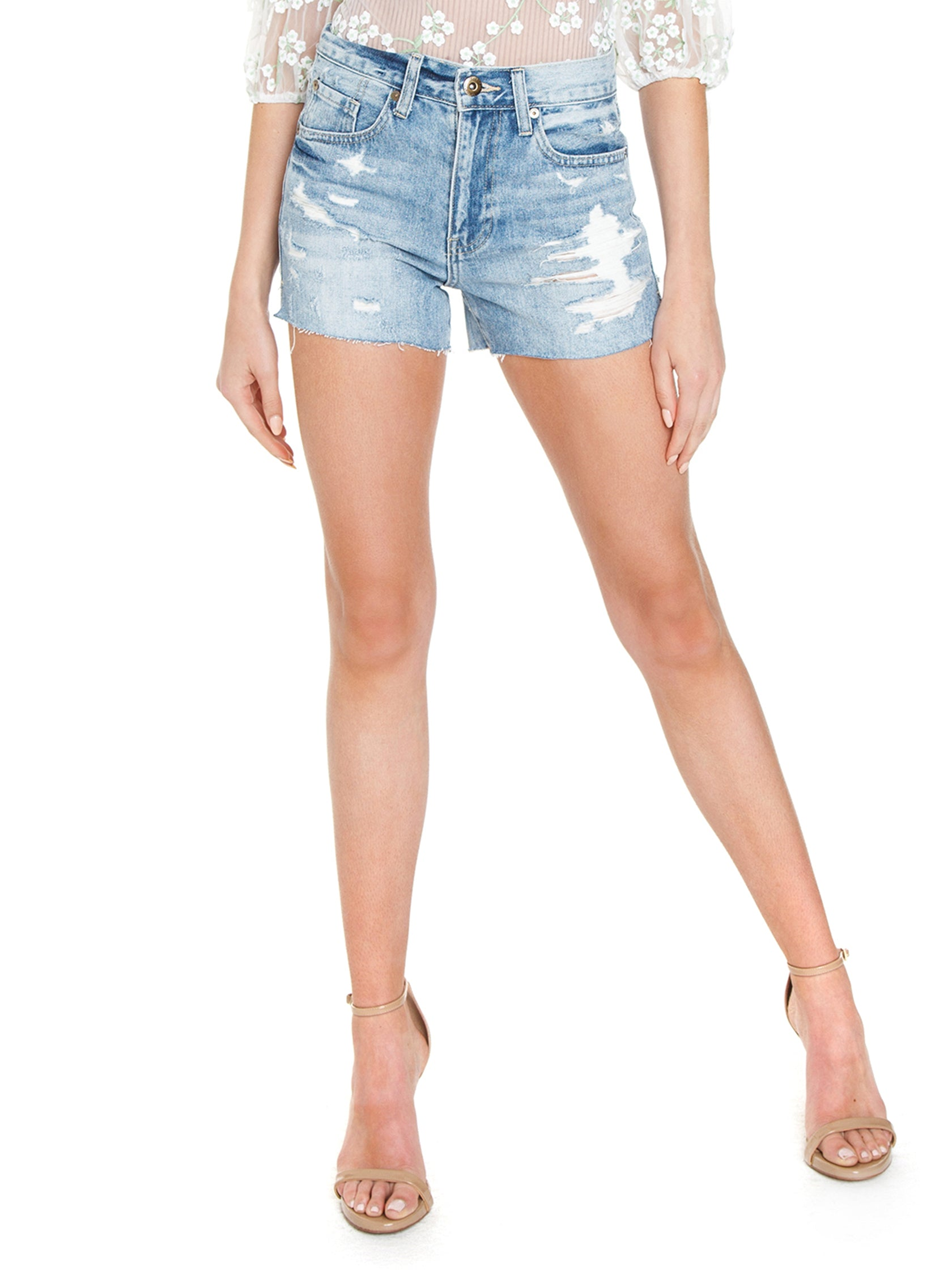 Woman wearing a shorts rental from PISTOLA called Santa Fe Shorts