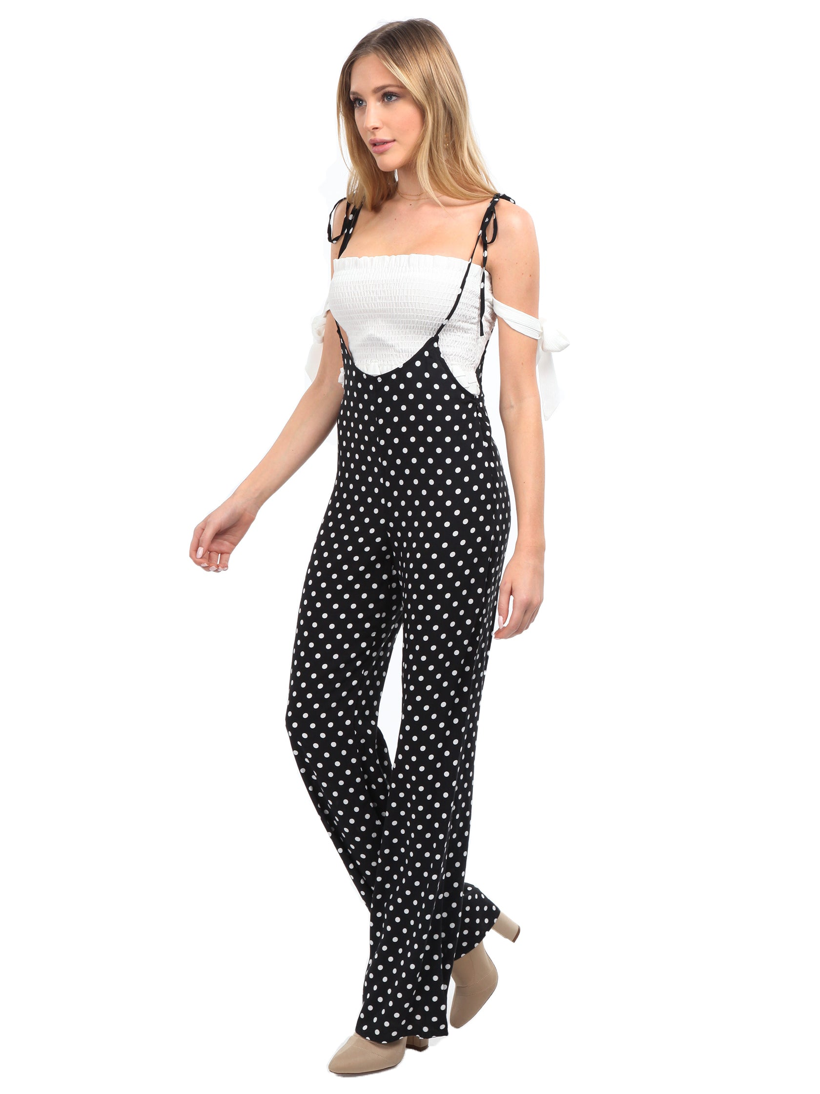 Woman wearing a jumpsuit rental from FashionPass called Sasha Polka Dot Jumpsuit