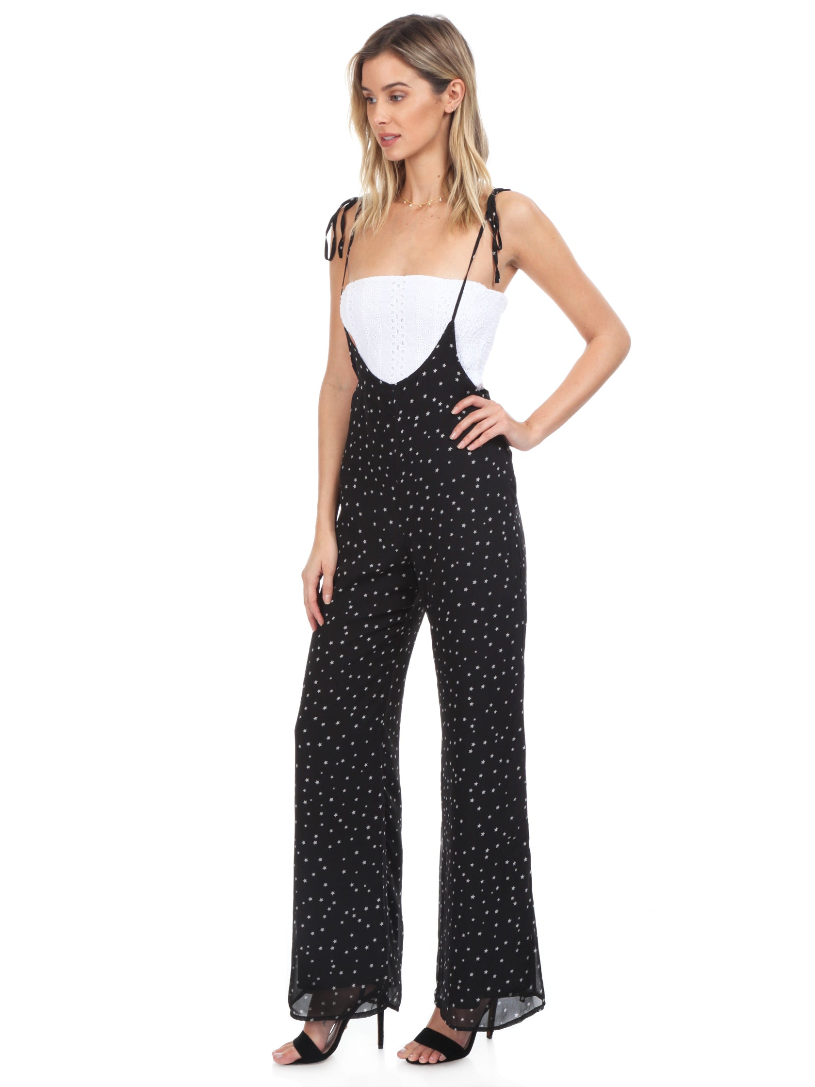 Woman wearing a jumpsuit rental from FashionPass called Sasha Star Print Jumpsuit