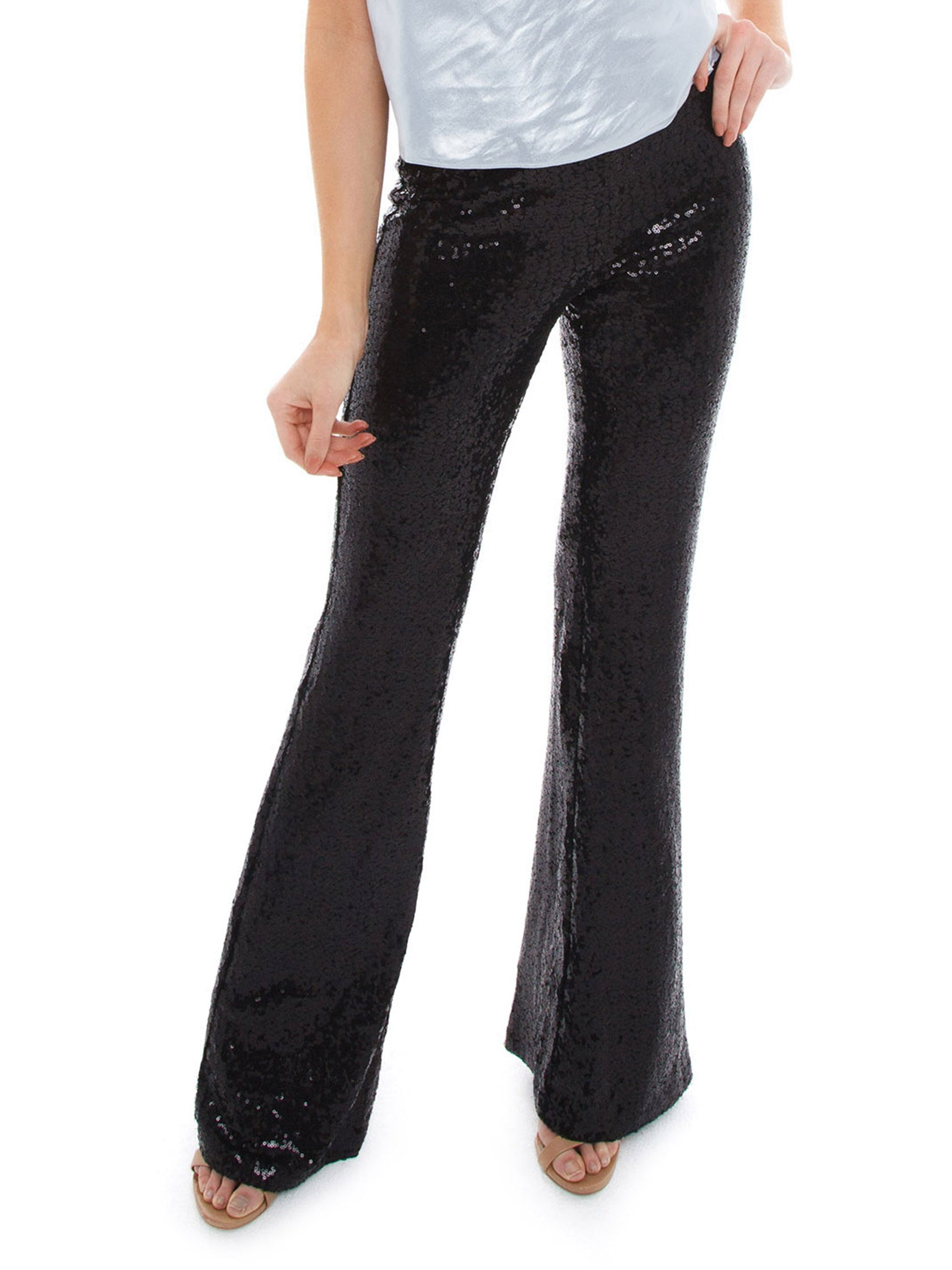 Woman wearing a pants rental from BB Dakota called Saturday Night Fever Sequin Flared Pant