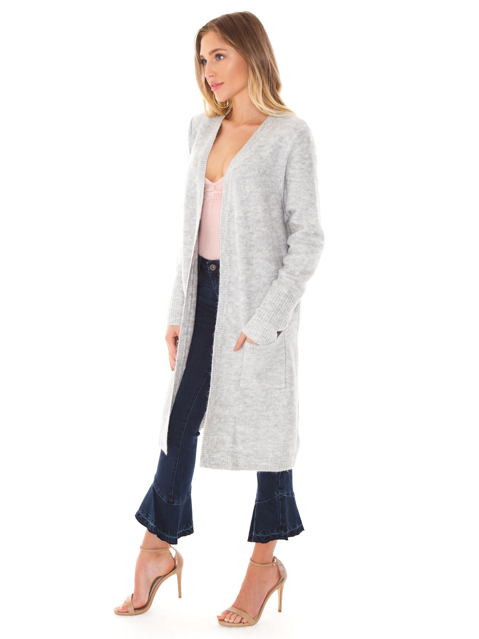 Woman wearing a cardigan rental from MINKPINK called Saturdays Longline Cardi