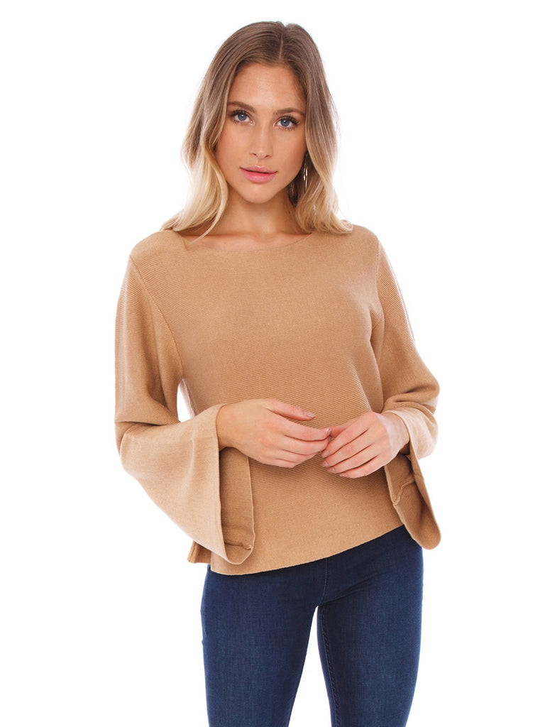 Girl wearing a sweater rental from Bishop + Young called Fireside Cropped Sweater