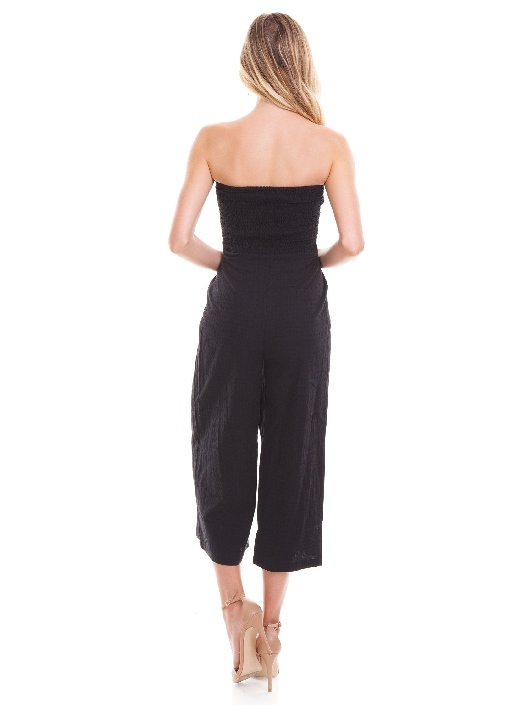 Women wearing a jumpsuit rental from MINKPINK called Say It Right Strapless Jumpsuit