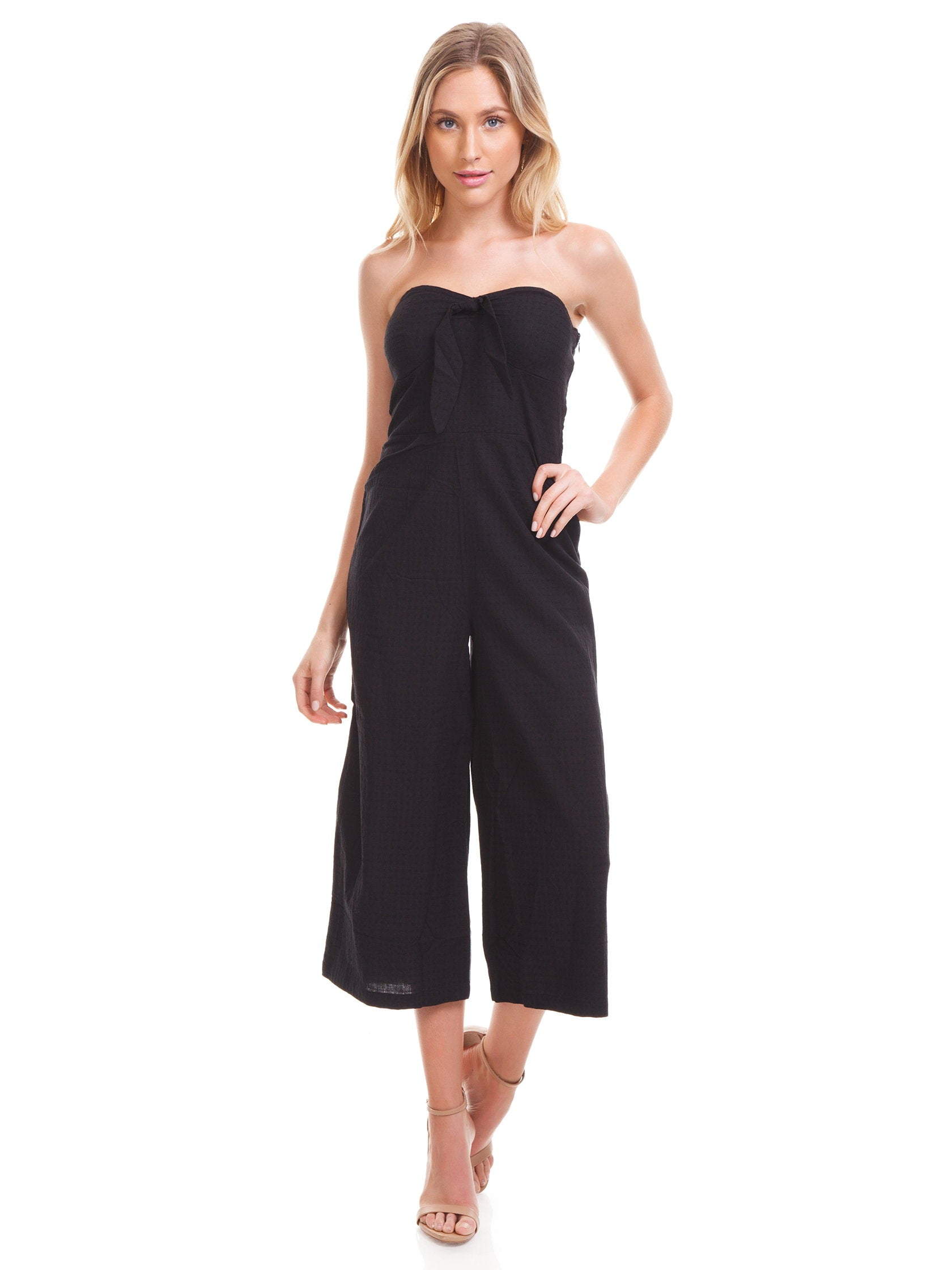 Girl outfit in a jumpsuit rental from MINKPINK called Say It Right Strapless Jumpsuit