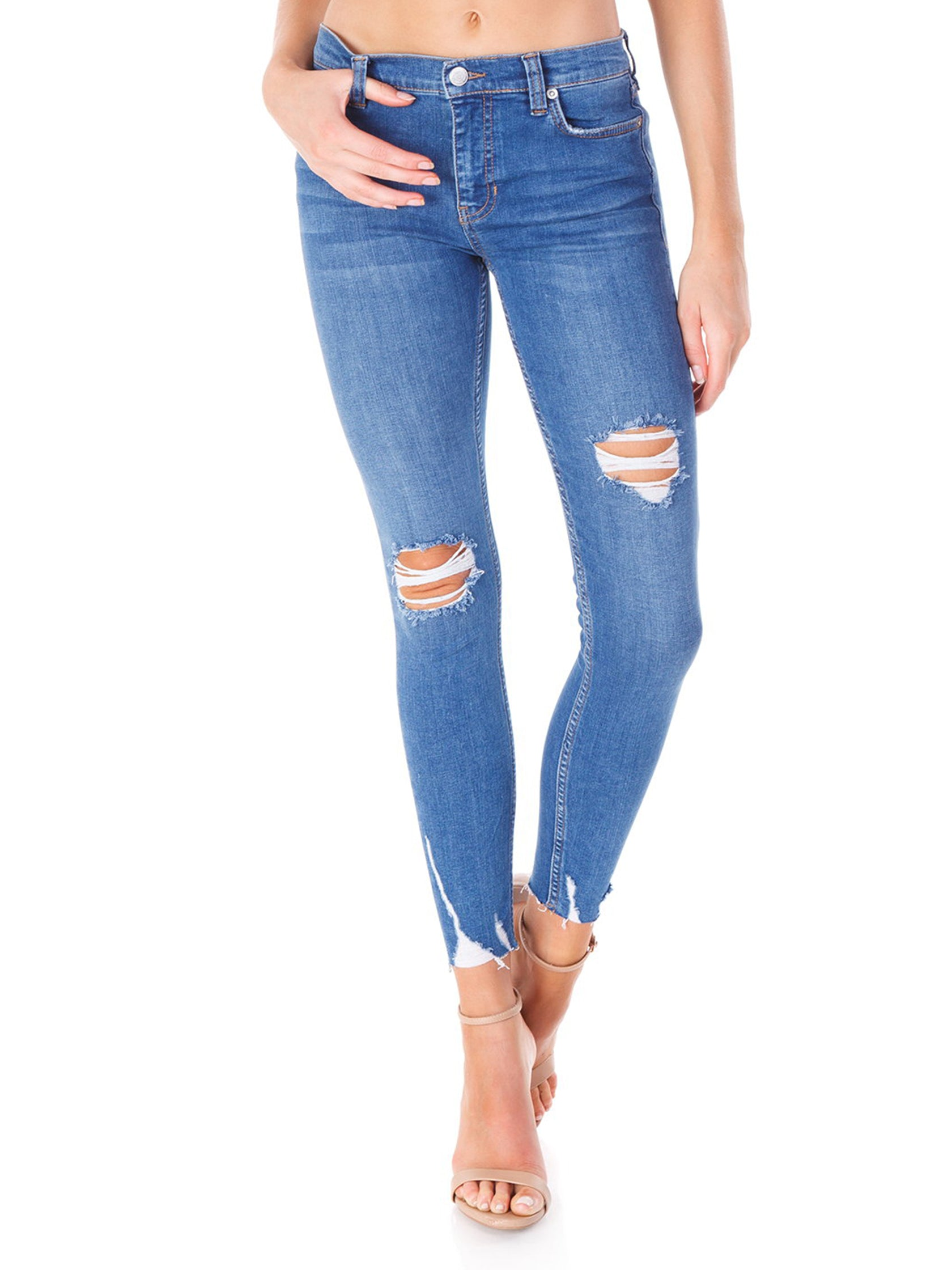 Woman wearing a denim rental from Free People called Shark Bite Jeans