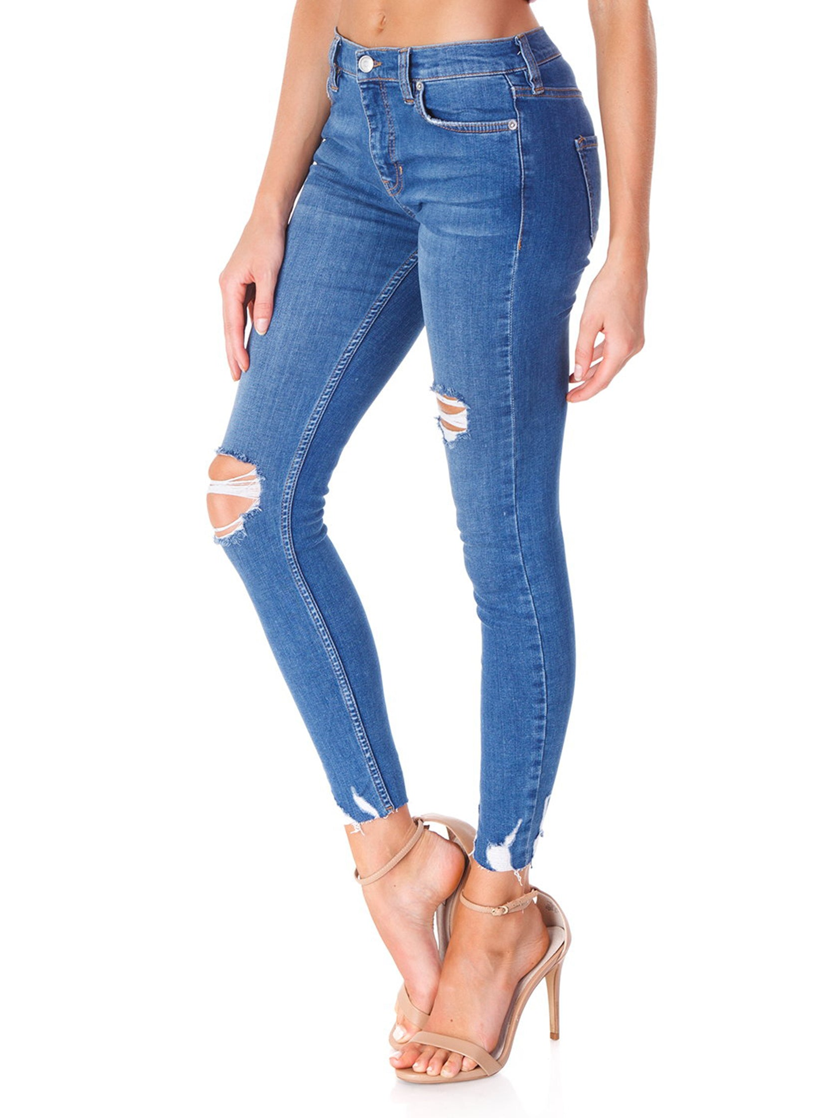 Women wearing a denim rental from Free People called Shark Bite Jeans