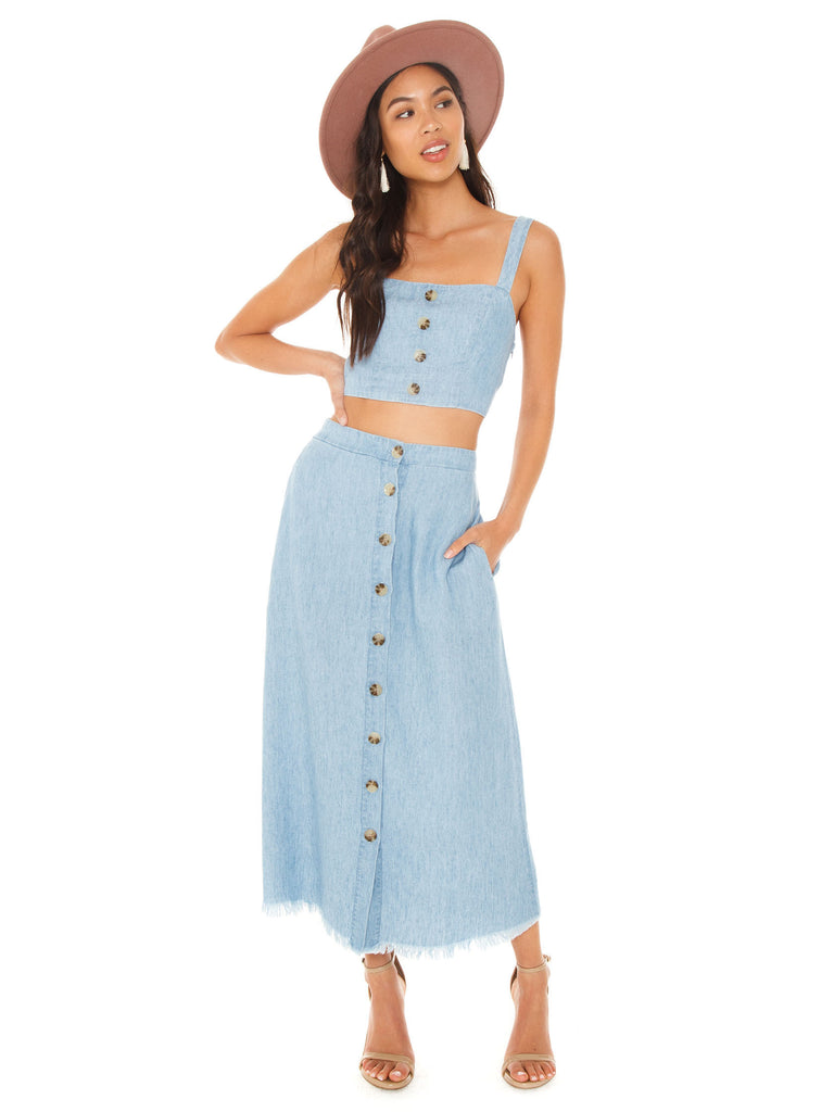 Girl wearing a skirt rental from Show Me Your Mumu called Heidi Ruffle Crop And Flirt Skirt