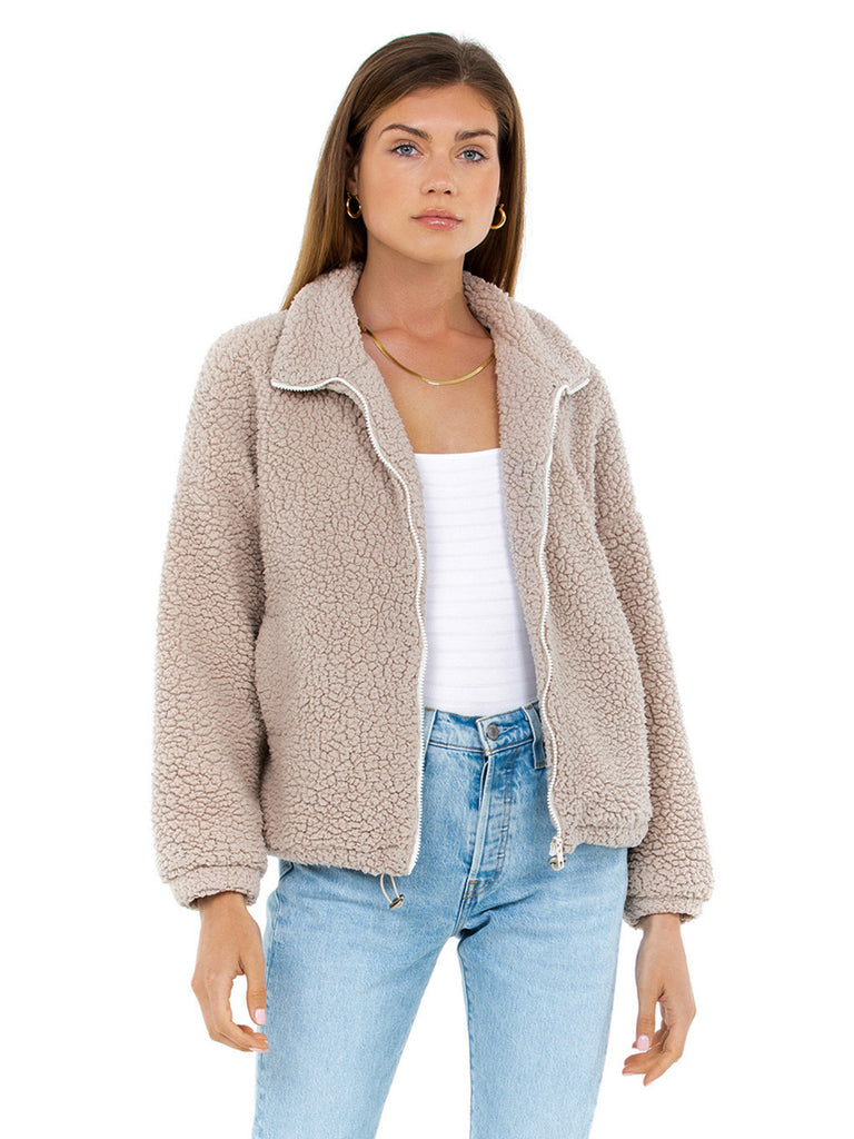 Woman wearing a jacket rental from SNDYS called Double Crossed Knit